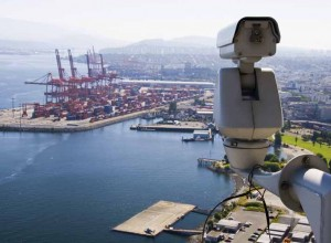 Surveillance Camera is watching  operation in the port.